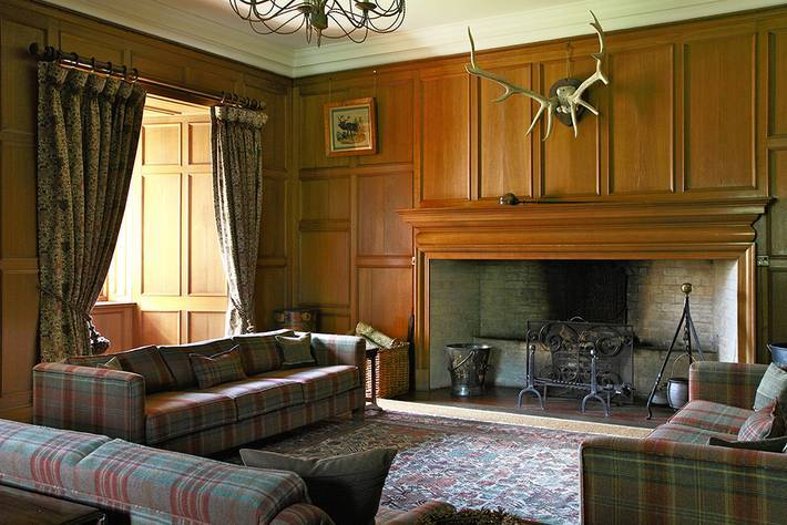 Tapestry Curtains And Plaid Upholstery Are The Perfect Combination With Antique Fumed Oak Paneling Of